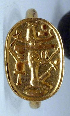 "Ring with device showing Shu upholding a divine bark, and in interstices the signs for ""Good God,"" ""Lord of the Two Lands,"" and ""Menkheperre""  Period: Third Intermediate Period–Late Period Dynasty: Dynasty 25-26 Date: ca. 750–650 B.C."