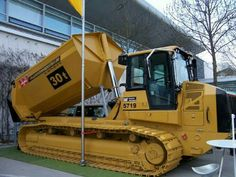 Not sure what model they are calling this.Looks like the rear of a Caterpillar track type loader based on excavator with dump body Heavy Construction Equipment, Construction Tools, Heavy Equipment, Dump Trucks, Cool Trucks, Big Trucks, Earth Moving Equipment, Caterpillar Equipment, Logging Equipment