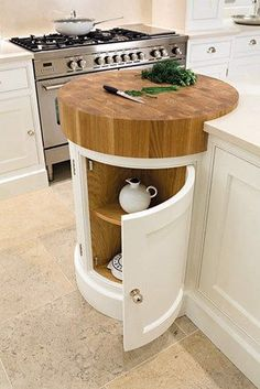 Coolest Idea Ever. Just a small spot to help prevent undue scratches if anyone is TEMPTED to cut anything WITHOUT a cutting board. Painted Kitchens - Painted Bespoke Kitchens - Tom Howley