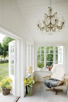 The wire chair with this as cushions/coverings; Gotland summer house garden Scandinavia ; Gardenista