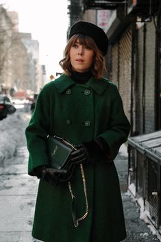 Green vintage coat and matching green YSL bag. Paired with black beret and black leather gloves. So chic!