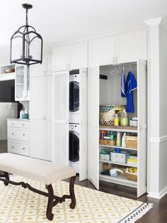 Love the washer/dryer stack and the closet of shelves next to it