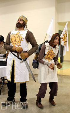 This might be one of my very favourite cosplays. The squires facial expression is priceless