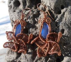My new design is earings in a shape of an orchid ( at least that's what I see ..:). Earings are made out of natural copper jewellery wire and beautiful blue sea glass. Price is 35$ (+4$ S/H). If you want to check out more of my work please visit Petra Designs facebook page.