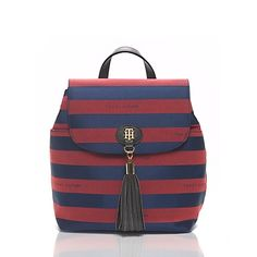 "Tommy Hilfiger women's bag. Stylish and functional, our rugby stripe backpack is surprisingly roomy and is ideal for hands-free toting.  <br/>• 100% nylon.<br/>• 11""(H) 11""(L)11"" (W) 5.""<br/>• Flap and zip closure, exterior zip pocket, interior zip pocket, TH signature button. <br/>• Spot clean.<br/>• Imported.<br/><br/>"