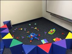 Infant area with sea turtles and octa with other little toys to play with along with a wall that had mirrors and toys to play with.