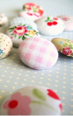 fabric buttons. Could make some out of my biz logo fabric and put on burlap bunting for shows.