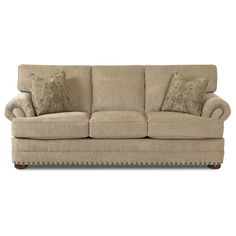 From the Clayton Collection, this sofa includes soft foam-filled T-seat and back cushions. The sturdy and comfortable platinum sofa contains tempered steel seat springs and sits atop lovely brown wood bun feet.