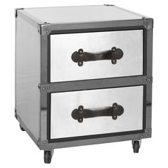 Metal chest with caster feet and faux leather accents.Product: ChestConstruction Material: Metal, MDF and faux leatherColor: Black and silverFeatures:Iron nailhead detailsTwo drawers Dimensions: H x W x D Metal End Tables, Wood Dust, Organic Modern, Space Furniture, Mdf Wood, Black And Brown, Black Silver, Kids Room, Drawers