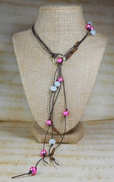 Medium short brown leather cord lariat bolo necklace. Pink and white milk glass beads, seed beads, Modern, fun, boho chic, simple, pretty by heathersfirenleather on Etsy