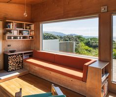 Built-in seating offers a view of the Kapiti Coast beach outside this bach renovated by Gerald Parsonson of Parsonson Architects. Photograph by Paul McCredie
