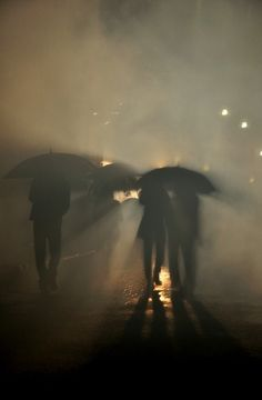Shadows under umbrellas.