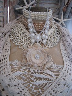 Vignettes Antiques Mannequin dress form draped in lace and pearls, pearl and roses necklace.