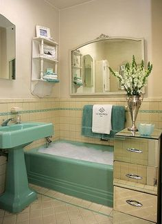This vintage bathroom reminds me of my parents' old bathroom with the sea foam green bathtub and sink. I LOVE the inclusion of that mirrored drawer though!