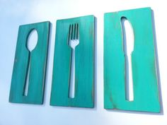 This wooden wall art plaque is three separate pieces of wooden boards with cut out spoon fork and knife. Distressed antiqued turquoise color