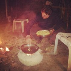 Outdoor cooking  on earthen fireware