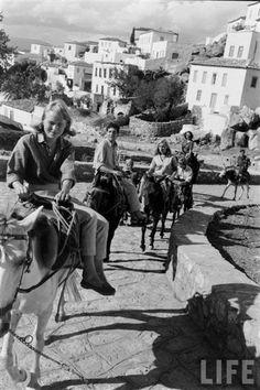 Leonard Cohen, Marianne and friends on a donkey ride, Hydra circa 1960