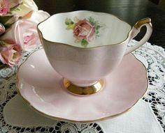 Pretty pink tea cup/saucer and red rose
