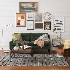 Scale: The scale is more focused on width in this living space. The gallery is hung, adding a sens eof height, but the rug, table, etc. draws your eyes to the ground and outwards.