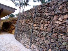 GABION Baskets - rocks in wire baskets - a big, solid solution to our big, tricky problem of how to prevent our hillside merging with our courtyard