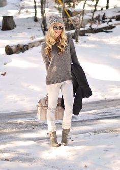 grey oversized sweater, white jeans, tan booties, black coat