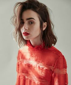 Actress Lily Collins wears Isabel Marant red top with matching red lipstick for DuJour Magazine October 2016