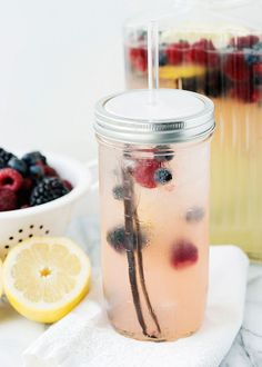 Vanilla Berry Lemonade-1 c water, 1 c sugar, 2 vanilla beans (seeded/split), 8-10 lemons, 5 c water, 2 c berries (rasp/blue/blackberries). Bring to a boil water/sugar/beans. Cook til sugar dissolves, begins to thicken slightly. Let cool. Juice lemons. Strain out pulp/seeds. Add 3/4 of the sugar mixture to pitcher, add lemon juice/water. Check sweetness. Add more vanilla syrup if needed. Add berries. Chill for 2 hours. Pour over ice, garnish with berries/ lemon slices.
