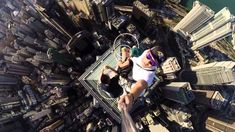 Three Photographers Take a Video Selfie Atop the Fifth-Tallest Skyscraper in Hong Kong