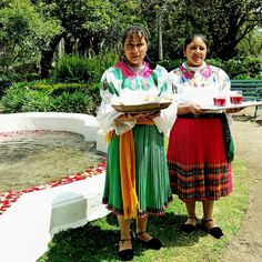 Two women in traditional clothing welcome visitors to La Compania Rose plantation offering #rose scented fruit juices and of course a rose.  #Ecuador is the 3rd largest producer of roses in the world and shows just how diverse the economy is in the region.  The temperate climates of the equator make this the perfect area for growing #roses. #VisitQuito #quito #igersquito #quitoecuador #quitocity #quitoturismo #travelwriter #instatravel #travelgram #travelblogger #wanderlust #instaTBN…