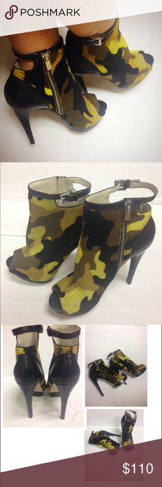 """Michael Kors Kendra Hair Calf Ankle Heels Booties Authentic new without box Michael Kors Kendra Chrome Dyed Hair Calf Camouflage Booties. Real Fur. Fur origin: Turkey. Peep-toe style. Rubber sole. Side zip. Heel height: approx. 5.5"""",. Platform height: approx. 1.25"""". Women's Size 9 1/2. Note that this is a display pair and may show signs of being tried on and displayed at the store. MICHAEL Michael Kors Shoes Ankle Boots & Booties"""