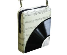 This small zip cross-body bag is made using music note sheet and vinyl record cut in quarter. It has a zipper closure and adjustable length strap made of vinyl. Perfect size for all types of. Gift For Music Lover, Music Gifts, Music Lovers, Blue Jean Purses, Teacher Bags, Student Teacher, 1st Wedding Anniversary Gift, Record Crafts, Recycled Gifts