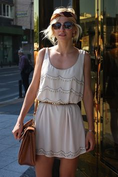 white summer dress with scalloped detail design and skinny gold waist belt
