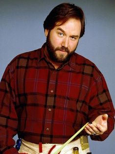 Become 'Al' with flannelette lumberjack red check shirt, denims, dark brown parted wig and full beard.