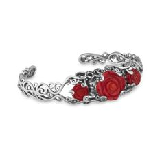 """The romance of red roses is captured in this feminine floral bracelet. Three finely detailed, carved red coral roses add bold color; sterling silver in a lacy, openwork scroll design makes this bracelet a distinctive piece. Elegant enough to accent a classic black dress yet simple enough to wear with jeans, bracelet measures 3/4"""" wide and fits an average-sized wrist. Made in America with gemstones from around the world."""