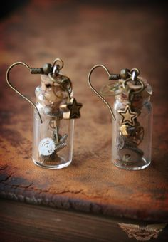 Time in a Bottle Steampunk Earrings. I would make it into a necklace for me & hubby to wear