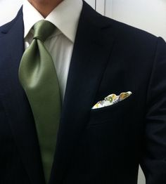 Navy suit with patterned pocket square