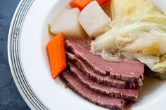 New England boiled dinner, a one pot dish consisting of corned beef or plain brisket, cabbage, carrots and potatoes.
