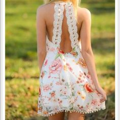 Double Zero Story of the South Dress Beautiful white floral dress with the BEST open back I've ever seen. Awesome crochet straps come down the back for an unexpected twist. Cute Pom-Pom balls line the bottom of the dress. NWT!! Double Zero Dresses Mini