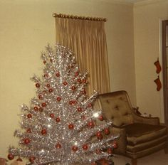 Aluminum Xmas Tree. When we tired of the Aluminum, my Dad bought cans of flocking and we had a Flocked tree, haha!