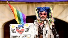 'Love is an awful thing to hate': A supporter of marriage equality at the Sydney rally.