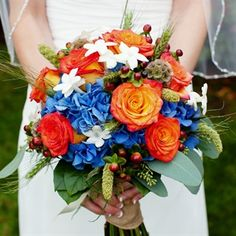 Hayleys bouquet included dark blue hydrangea at the base with her favorite Circus roses, which also compliments the blue very well. There is an accent of chocolate hypericum berries, stephanotois and grey green wheat's. It was bundled together with natural burp ribbon.