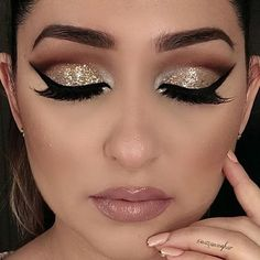 Glittery eyes with black winged liner and a pinkish-nude lip....gorgeousness!!!:):)