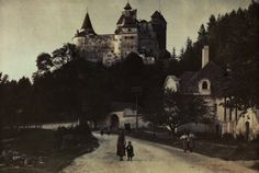 People walk along the road with Bran Castle behind them. Bran Castle Romania, National Geographic Images, Dracula Castle, Art For Art Sake, Color Photography, Vintage Photographs, Image Collection, Old Photos, Places To Visit