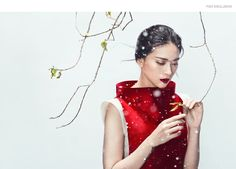 """""""Winter's End"""" captures actress Ngo Thanh Van in a striking mix of vibrant red against snow and flowers. Photos by Zhang Jingna for Phuong My's holiday 2015 collection"""