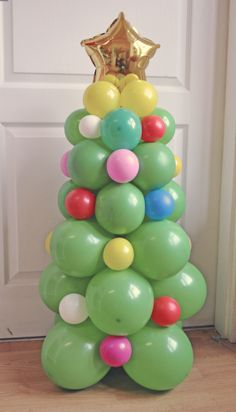We made some balloon decorations for Christmas.Its height is 36 inch and maybe with decorations like these we will save some trees this year.