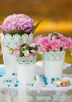Could replicate this look with doilies. I like the lace top look. pink peonies and a gray bow around it, maybe on the head table for bridal party bouquets? Simple Wedding Centerpieces, Diy Wedding Flowers, Wedding Table Decorations, Wedding Flower Arrangements, Floral Centerpieces, Floral Wedding, Floral Arrangements, Table Centerpieces, Potted Plant Centerpieces