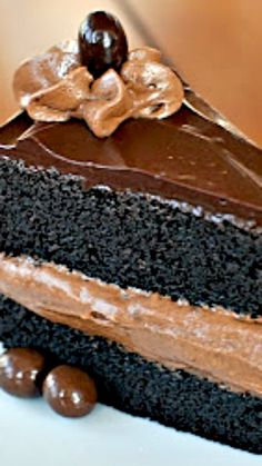 Midnight Sin Chocolate Cake with Chocolate Mousse Filling and ganache glaze ~A  rich, moist chocolate cake.