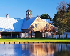 Oh, so beautiful on the outside... And on the inside you\'ll find horse stalls and paddock doors.