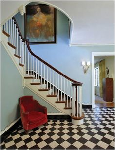 Dream foyer, minus hideous chair and painting. Light blue walls, white trim/ceiling, and black and white tile floor <3