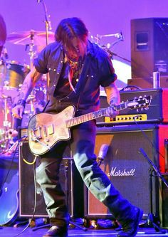 Johnny Depp playing his specially designed guitar